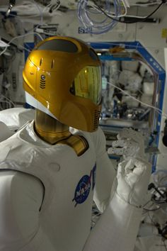 Image brought to you courtesy of www.robotradio.com | Cosmic Streams of Consciousness | Images to listen to..| Robonaut is an actual robot working on the space station. Here he is testing human-machine combined capability. Today we brought Robonaut to life on Space Station.