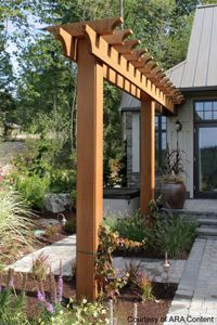 Support for the downspout to redirect it over the walkway.