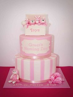 A two tiered ink and white creation for a little girl. The toy box topper was made from RKT and finished in fondant and gum paste detailing. The plaque was drawn freehand