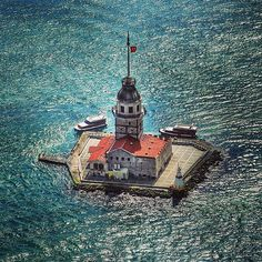 The Maiden's Tower, also known as Leander's Tower since the medieval Byzantine period, is a tower lying on a small islet located at the southern entrance of the Bosphorus strait 200 m from the coast of Üsküdar in Istanbul, Turkey. Places Around The World, Around The Worlds, Dream City, Turkey Travel, Go Kart, Amazing Destinations, Places To See, Egypt, Beautiful Places