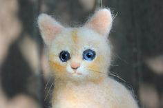 Needle felted  cat.  Miniature soft sculpture by DaliaNerijusFelt