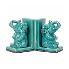 These beautiful turquoise Buddhist-influenced Elephant Bookends are a unique and rich addition to your bookcase or mantel. In Buddhism, the elephant is seen as a source of strength, steadfastness, and responsibility. Adorn and inspire your room with these symbolic stoneware masterpieces.