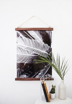 21 Wall Art Projects That Are Actually Affordable - DIY Palm Leaves Wall hanging frame at Design*Sponge - Diy Wand, Hanging Frames, Diy Hanging, Hanging Posters, Hanging Wall Art, Mur Diy, Cuadros Diy, Diy Wall Art, Fabric Wall Art