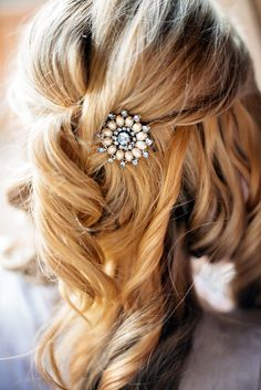 Brooch in Curled Half-Up Hairstyle | Photography: Lauren Brown Photography. Read More: http://www.insideweddings.com/weddings/intimate-destination-wedding-at-mountain-lodge-in-big-sky-montana/711/