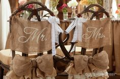 We absolutely adore this idea of tying together the Bride and Grooms chairs.