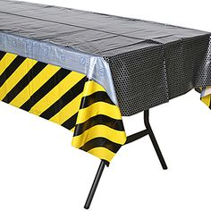 Our Construction Zone Table Cover features a work zone themed design that is accented with black and yellow stripes along the border.