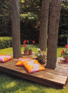 What a great way to cover up exposed roots and dirt patches under trees! Turn it into a relaxing resident reading area! I LOVE THIS for curb appeal if it can be seen from the street. I know what you are thinking about the pillows! Bring them in at night! I just LOVE how they brighten up the space!