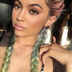 Kylie Jenner showcases her new lipgloss at Coachella | DRESSR