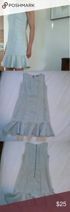 Sleeveless Ruffle-hemmed Mini Dress, Medium Blue and ivory brocade slim fit dress with adorable ruffled hem.   Exposed zipper in back. Size medium.  (For reference, I usually wear size 28 jeans, small or medium tops) 61% polyester, 38% cotton.  Flattering cut. Stuctured, not spandex Great condition. Worn twice. Perfect for weddings and baby showers and other spring fun! Dresses Mini