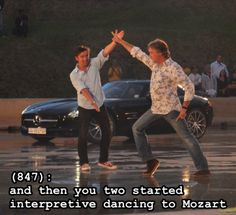 """In a picture from a Top Gear Live performance we have Richard Hammond and James May, mid performance. James is doing some sort of variation on the Saturday Night Fever dance while Richard has his arms outspread as if to say """"Look at this idiot."""" The caption reads: """"(847): and then you two started interpretive dancing to Mozart""""}"""
