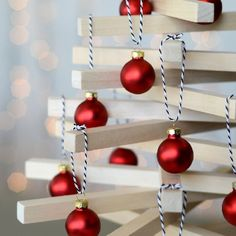 Make a festive tabletop Christmas tree with a Scandinavian vibe using wooden dowels from the craft store. It packs flat too!