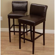 Enhance your decor and update the seating at your bar or counter-height table with these cushioned leather counter stools in a rich and inviting dark brown color. Straight legs and a mid-height back complete the contemporary design.