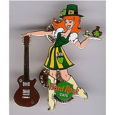 "Looks like this is St. Patrick's Day, but maybe from ... Amsterdam? Can't read it...  http://hardrockcafepins.com/commerce/default.php?manufacturers_id=15  Yep, ""St. Patrick's Day 2001 - Girl holding Tray and brown Guitar from the Hard Rock Cafe in Amsterdam, The Netherlands. Limited edition of 250 made."""