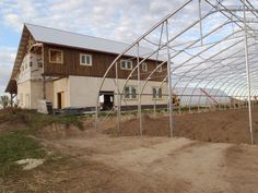 Straw bale barn and Buried quonset hut root cellar by Endeavour Centre