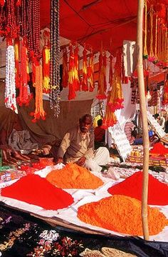 Dyes and prayerbeads on the River Ganges. Varanasi, India.