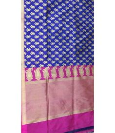 Blue Banarasi Handloom Pure Katan Silk Saree --------------------------------------------------------------Drape yourself with grace as you step out with the confidence brought out by this Blue with pink border Banarasi saree.  Matching your saree  with exquisite jewelry can be a good option.