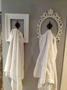 Hack. Use picture frames and hooks for his and her towels