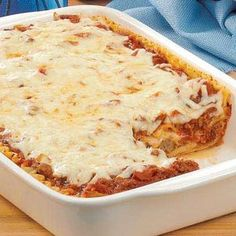"""Meatball Lasagna ~ Addella Thomas of Mt. Sterling, Illinois crumbles leftover meatballs into the homemade spaghetti sauce she uses in this cheesy lasagna. """"My family wants me to make this dish all the time. It goes over well at reunions, too,"""" she adds."""