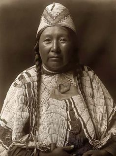 Here for your consideration is a pleasing picture of Wife of Mnainak, a Yakima Woman. It was created in 1910 by Edward S. Curtis.    The photograph presents the Yakima woman in a half-length portrait, facing front.    We have created this collection of illustrations primarily to serve as a valuable educational tool. Contact curator@old-picture.com.