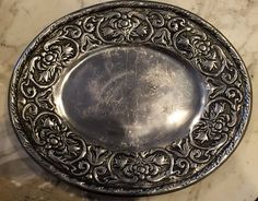 A personal favorite from my Etsy shop https://www.etsy.com/listing/268234421/vintage-pewter-serving-plate-the-wilton