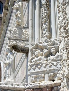 Messina | A detail of the magnificent late-Gothic early- 15th century central portal of the Duomo (Cathedral). It is adorned with representations in marble of men, animals and plants.