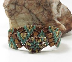 SUPERDUO CZECHMATE TILE Wiggle Bracelet-Bronze Luster Opaque Red Tiles-Turquoise Picasso and White Picasso SuperDuos-Toho Seed Beads (DR90) by CinfulBeadCreations on Etsy