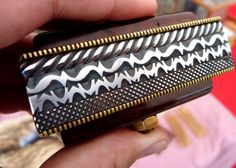"""baseballfury:  An example of the stunning pattern-filing skillspossessedby knifemaker Dennis Bradley. 2012 """"Hammer-in"""" in Blairsville, Georgia. The Hammer-in is an annual event that demonstrates the techniques that knifemakers use to create amazing works of art."""