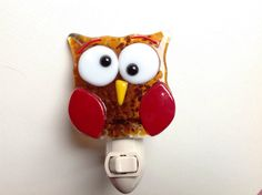 This is owl is perfect for a nursery. It has perfect shades of opal and transparent glass in assorted brown and red shades.    The piece is handcrafted