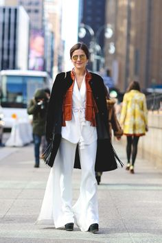 Lessons In Layering From The Streets Of New York City #refinery29  http://www.refinery29.com/2016/02/103173/ny-fashion-week-fall-winter-2016-street-style-pictures#slide-101  White, summery separates aren't off-limits in cold weather. Here's how to make them work....