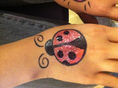 Glitter Lady Bug beetle bird face paint cheek art design