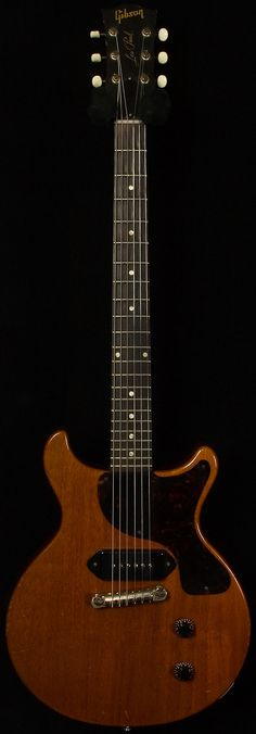Part way through Gibson updated the Les Paul Junior. Changes included a new double cutaway body-shape with rounded horns as well as a new standard Cherry Guitar Pics, Music Guitar, Cool Guitar, Playing Guitar, Fender Telecaster, Epiphone, 1959 Gibson Les Paul, Gibson Guitars, Fender Guitars