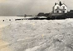 The icy sea and snow covered shore in Whitstable, Kent in 1963. The winter was the coldest in England since 1740.