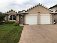 New Listing - 818 Denham Crescent, Saskatoon 3 bedroom, 3 bath bungalow with a double attached garage and a walkout basement in Saskatoon's Hampton Village neighbourhood