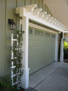 Garage Door Arbor great way to increase curb appeal is with an arbor over the garage door. A manual post hole digger i. Garage Door Arbor great way to increase curb appeal is with an arbor over the garage door. A manual post hole digger i. Garage House, House Yard, Style At Home, Door Arbor, Garage Pergola, Pergola Kits, Garage Trellis, Pergola Ideas, Pergola Roof