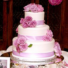 wedding cakes with real yellow roses   ... decorated white cake is splashed with lavender roses and ribbon
