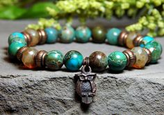 Owls represent wisdom, mystery and intuition. This Gemstone Bracelet made with 8mm Imperial Jasper with high quality Czech beads and an Owl Charm. Imperial Jasper Properties: It is a nurturing and gro
