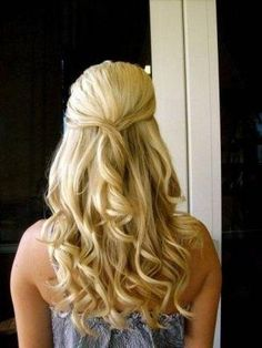 full and wavy half up blonde hair