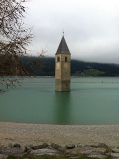 Reschensee- actually a very sad place:163 homes were submerged for this artificial lake.
