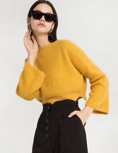 "Yellow Mustard Crop Sweater with Scalloped Hem Made by us70% angora, 30% rayonLength 24""Model is wearing a size small and model's height is 5.8""Color varies"
