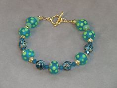 Aqua and lime dotted lampwork bead bracelet with by wilywolverine, $42.95