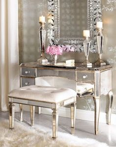 Love that mirrored furniture is so in style right now. Something very old Hollywood glamour about it.
