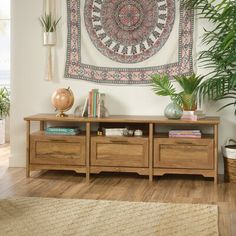 """Bay Isle Home Is your home beginning to look a little boring and bland? Add a fresh new look of tropical-inspired design and beauty to any room with this credenza. This TV stand accommodates up to a 75"""" TV, making it the perfect spot for binge-watching your favorite show or catching the big game. This entertainment credenza's spacious open shelf provides you with room for audio/video components and home decor items like framed photos and knick-knacks. This TV credenza features three drawers…"""