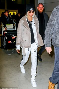 Show your sporty side in a Puma track jacket like Cara. Click 'Visit' to buy now. #DailyMail