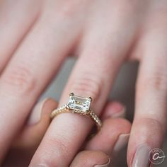 Yellow gold emerald cut engagement rings at Razny Jewelers