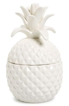 This ceramic pineapple jar is perfect for storing cookies and is sure to add a tropical punch to the kitchen décor.