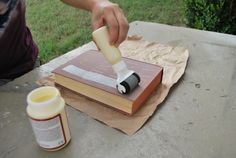 How to recover a book, step-by-step.  There is even a picture of different ModPodge finishes!