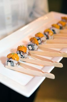 Napkins are a must when serving these elaborate sushi rolls as wedding appetizers.