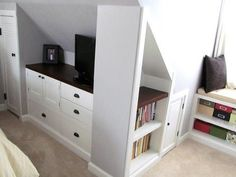 Repurposed dressers, doors and drawers, cut down to size, create handy storage under the eaved walls in this attic bedroom. For more ways to squeeze in storage, visit our Pinterest board Brilliant Built-Ins. | thisoldhouse.com
