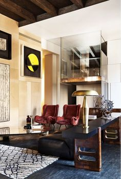 Art Decor living room with arm chairs, brass lamp, a high-mounted art // Vincenzo De Cotiis Interior Design