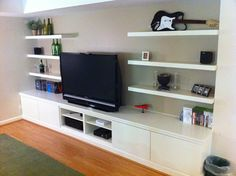Ikea hack - 3 BESTA shelf units, 4 BESTA VARA drawer fronts, 6 Lack wall shelves - like the idea not the color and wouldn't want IKEA, but it's a thought for the TV room! Description from pinterest.com. I searched for this on bing.com/images